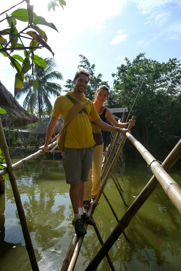 Subtly color-coordinated (that's how we roll) we walk the fine bamboo line that is a bridge at the crocodile farm. But don't get excited, there are no crocs below