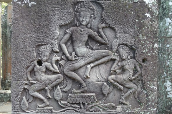 A group of three Apsaras caught in a traditional dance pose. One thing to remember, if you've never seen them in real-life, is that traditional Khmer dance is more of a slow succession of contortionistic poses that ballet per se