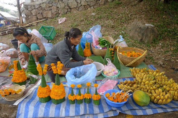 Preparing beautiful offerings out of marigolds and banana leaves for the local temples. Clueless as we are, we bought bananas to eat from these ladies; sorry bananas who were hoping to make it into Buddha's prodigious belly ...
