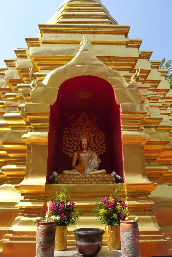 One of the many golden Buddha statues in a temple in Chang Mai
